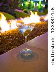martini by gas fire pit   Shutterstock . vector #133881458
