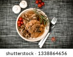 stewed pork chop in a bright... | Shutterstock . vector #1338864656