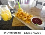 fried calamari rings and mango... | Shutterstock . vector #1338876293