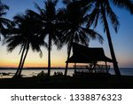 tourists sitting by exotic... | Shutterstock . vector #1338876323