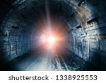 light in end of tunnel. long... | Shutterstock . vector #1338925553