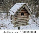 A Wooden Birdhouse Shaped Like...