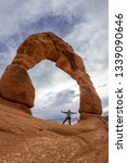 man standing at the base of... | Shutterstock . vector #1339090646