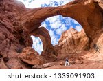 woman standing at the base of... | Shutterstock . vector #1339091903