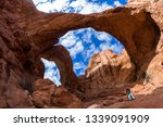 woman standing at the base of... | Shutterstock . vector #1339091909
