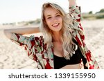 exited blond woman with perfect ... | Shutterstock . vector #1339155950