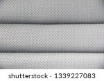 perforated leather background.... | Shutterstock . vector #1339227083