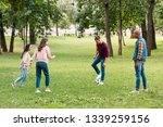 cheerful multicultural group of ... | Shutterstock . vector #1339259156