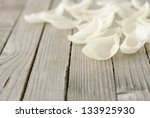 Stock photo white petals on wooden 133925930