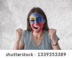 young woman with painted flag... | Shutterstock . vector #1339353389