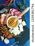 antipasti on white plate and on ... | Shutterstock . vector #1339381796