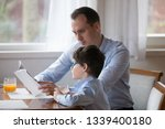 father reading book to son... | Shutterstock . vector #1339400180