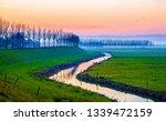 rural field river sunset fog...   Shutterstock . vector #1339472159