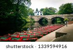 Array Of Rowboats And Bridge In ...