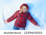 happy child girl playing on a... | Shutterstock . vector #1339643033