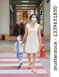 mother and her daughter walking ...   Shutterstock . vector #1339651850