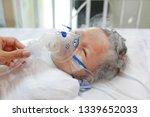 toddler boy using nebulizer to...   Shutterstock . vector #1339652033