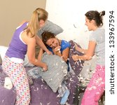 Teenager Girls Pillow Fighting...