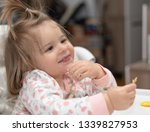 sweet 17 months old baby girl...   Shutterstock . vector #1339827953