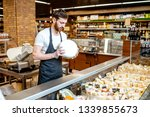 portrait of a cheese seller in... | Shutterstock . vector #1339855673