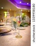 glass on wedding banquet table    Shutterstock . vector #1339958180