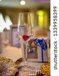 glass on wedding banquet table    Shutterstock . vector #1339958399