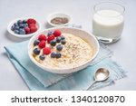oatmeal with berries  chia ...   Shutterstock . vector #1340120870