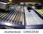 Zoomed view on sound mixer with regulation buttons - stock photo