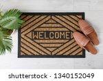 door mat with word welcome and...   Shutterstock . vector #1340152049