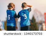young footballers standing in... | Shutterstock . vector #1340173703