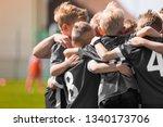 junior football team stacking...   Shutterstock . vector #1340173706