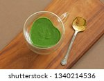 spinach smoothie on wooden... | Shutterstock . vector #1340214536