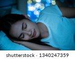 asian women sleeping happily... | Shutterstock . vector #1340247359