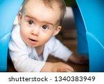 Caucasian Baby Girl Squeezing...