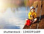 Little Boy Siting On A Wooden...