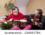 two women make a music therapy... | Shutterstock . vector #134041784
