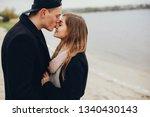 loving couple in a black... | Shutterstock . vector #1340430143