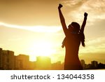 happy successful sportswoman... | Shutterstock . vector #134044358