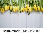 Row Of Fresh Yellow Tulips On...
