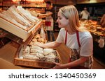 young woman hold bakset with... | Shutterstock . vector #1340450369