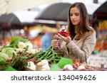 Young Woman Buying Red Hot...