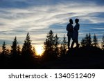 silhouettes of young couple in... | Shutterstock . vector #1340512409