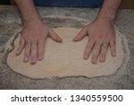 male hands preparing dough  for ... | Shutterstock . vector #1340559500