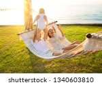 happy family on a tropical... | Shutterstock . vector #1340603810