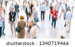 defocused crowd of people... | Shutterstock . vector #1340719466