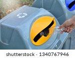 hand putting plastic bottle in... | Shutterstock . vector #1340767946
