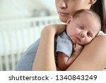 young woman with her newborn... | Shutterstock . vector #1340843249