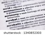 Small photo of Blurred close up to the partial dictionary definition of Acrimony
