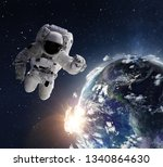 flying astronaut operating in... | Shutterstock . vector #1340864630