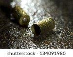 Bullets On Ground On Rainy Day